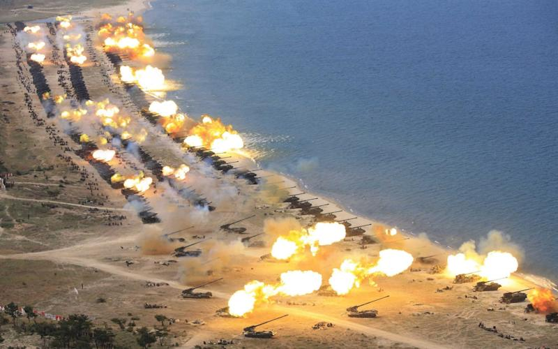 An undated photograph released by the Korean Central News Agency (KCNA) on 26 April 2017 shows the combined fire demonstration of the services of the Korean People's Army in celebration of its 85th founding anniversary, at an undisclosed location in North Korea - Credit: KCNA