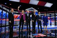 US presidential hopeful Mike Bloomberg (L), the former mayor of New York, joined his fellow Democrats on stage for the first time for their ninth debate of the party's nomination process on February 19