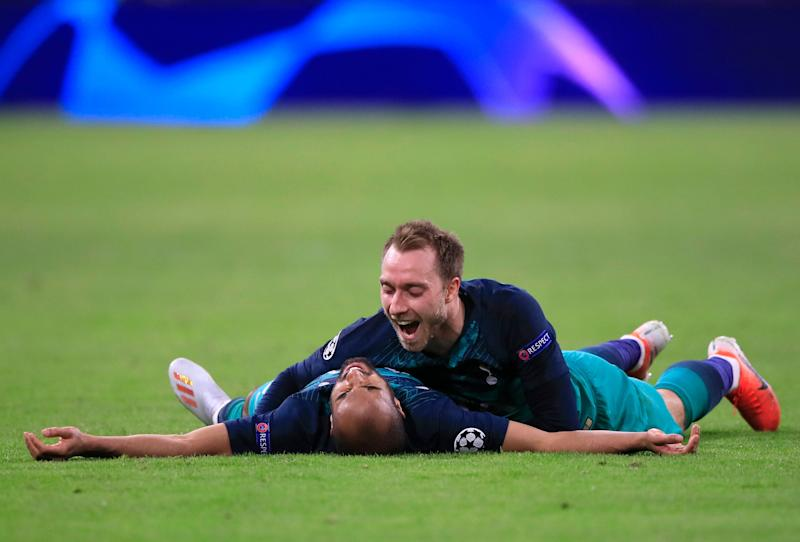 Tottenham's Christian Eriksen celebrates with teammate Lucas Moura, left, at the end of the Champions League semifinal second leg soccer match between Ajax and Tottenham Hotspur at the Johan Cruyff ArenA in Amsterdam, Netherlands, Wednesday, May 8, 2019. (AP Photo/Peter Dejong)