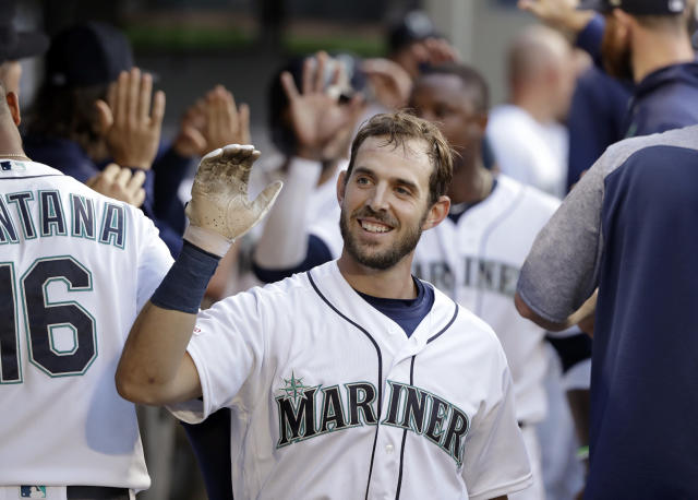 Seattle Mariners' Austin Nola is congratulated on his three-run home run against the Texas Rangers in the second inning of a baseball game Monday, July 22, 2019, in Seattle. (AP Photo/Elaine Thompson)