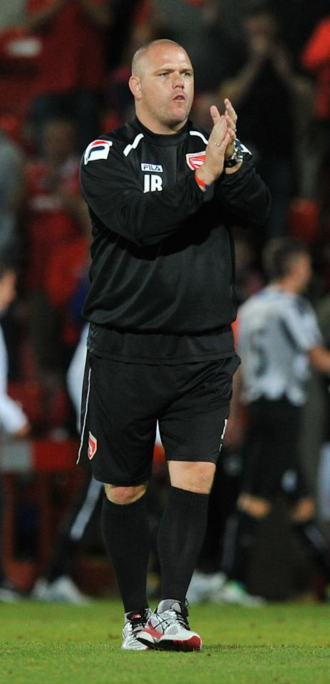 Morecambe's Manager Jim Bentley applauds the fans at the final whistle during the Capital One Cup, Second Round match at the Globe Arena, Morecambe.
