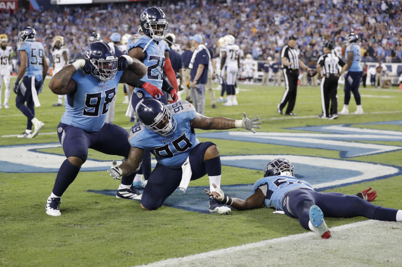 Tennessee Titans defenders Tennessee Titans defenders Jeffery Simmons (98) and Jurrell Casey (99) celebrate after stopping the Los Angeles Chargers on their final drive of the game in the fourth quarter of an NFL football game Sunday, Oct. 20, 2019, in Nashville, Tenn. The Titans won 23-20. (AP Photo/James Kenney)