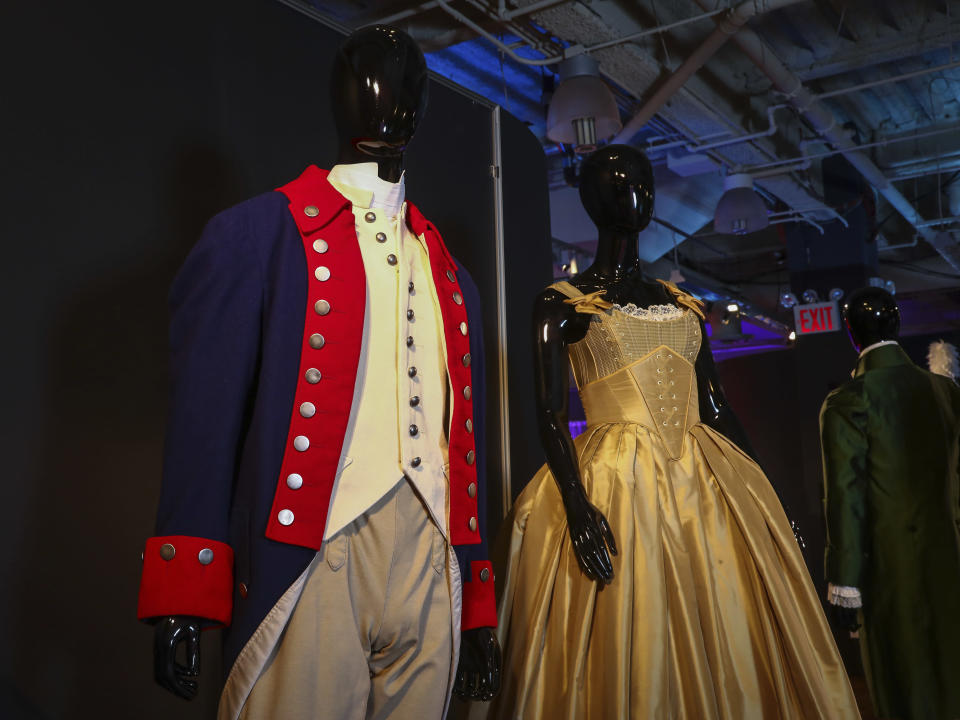 """Costumes from the Broadway musical """"Hamilton"""" are displayed at the """"Showstoppers! Spectacular Costumes from Stage & Screen"""" exhibit, benefitting the Costume Industry Coalition Recovery Fund, in Times Square on Monday, Aug. 2, 2021, in New York. (Photo by Andy Kropa/Invision/AP)"""