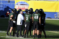 Hawaii head coach Todd Graham talks to his team during a timeout in the second quarter of the New Mexico Bowl NCAA college football game against Houston in Frisco, Texas, Thursday, Dec. 24, 2020. (AP Photo/Matt Strasen)