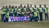 The Pakistani cricket team poses with the winners trophy of the Twenty20 series at a ceremony after the 3rd Twenty20 cricket match against Zimbabwe at the Pindi Cricket Stadium, in Rawalpindi, Pakistan, Tuesday, Nov. 10, 2020. Pakistan won the series 3-0. (AP Photo/Anjum Naveed)