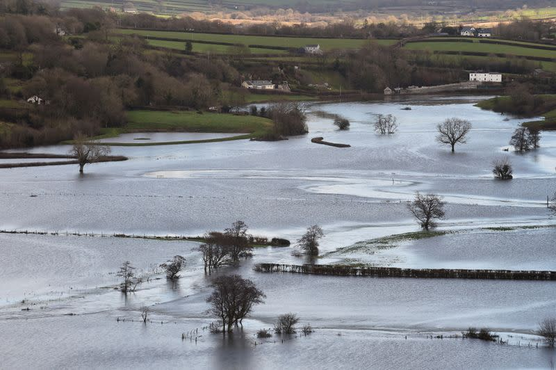 FILE PHOTO: Flooded fields are seen after Storm Christoph hit Wales bringing torrential rain and floods, near Carmarthen, Wales, Britain January 21, 2021.