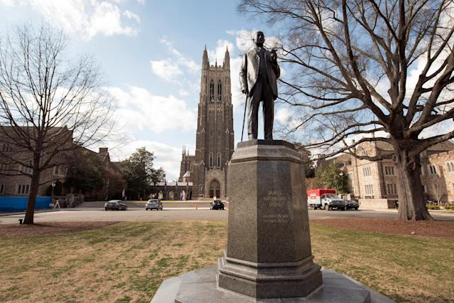 A general view of the Duke University Chapel and a statue of James Buchanan Duke on the Duke University campus. (Getty file photo)