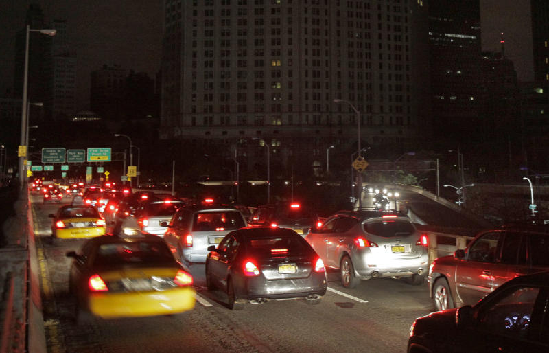 Early morning commuters cross New York's Brooklyn Bridge, Wednesday, Oct. 31, 2012. Morning rush-hour traffic appeared heavier than on an ordinary day as people started to return to work in a New York without functioning subways. Cars were bumper-to-bumper on several major highways. (AP Photo/Richard Drew)