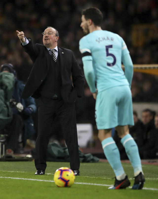 Newcastle United manager Rafael Benitez give instructions during the English Premier League soccer match between Wolverhampton Wanderers and Newcastle United, at Molineux, in Wolverhampton, England, Monday, Feb. 11, 2019. (Nick Potts/PA via AP)
