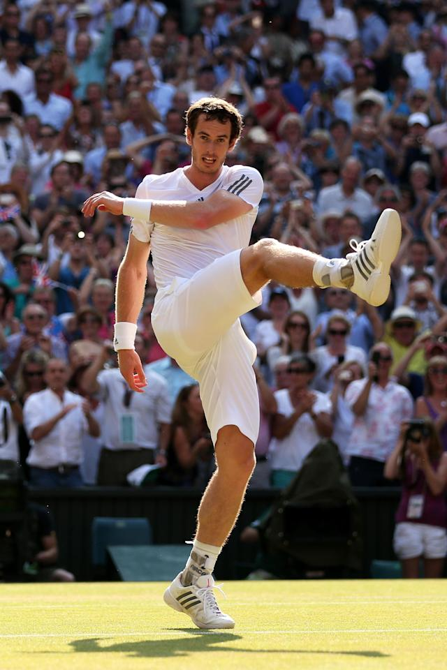 LONDON, ENGLAND - JULY 07: Andy Murray of Great Britain kicks a tennis ball as he celebrates victory in the Gentlemen's Singles Final match against Novak Djokovic of Serbia on day thirteen of the Wimbledon Lawn Tennis Championships at the All England Lawn Tennis and Croquet Club on July 7, 2013 in London, England. (Photo by Clive Brunskill/Getty Images)