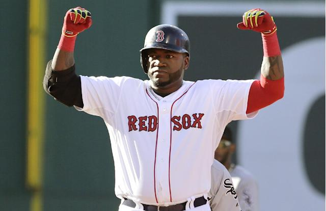 Boston Red Sox designated hitter David Ortiz raises his arms as he stands on second base after his two-rbi double, which broke a 1-1 tie, during the sixth inning of a baseball game against the Chicago White Sox at Fenway Park in Boston, Thursday, July 10, 2014. (AP Photo/Charles Krupa)
