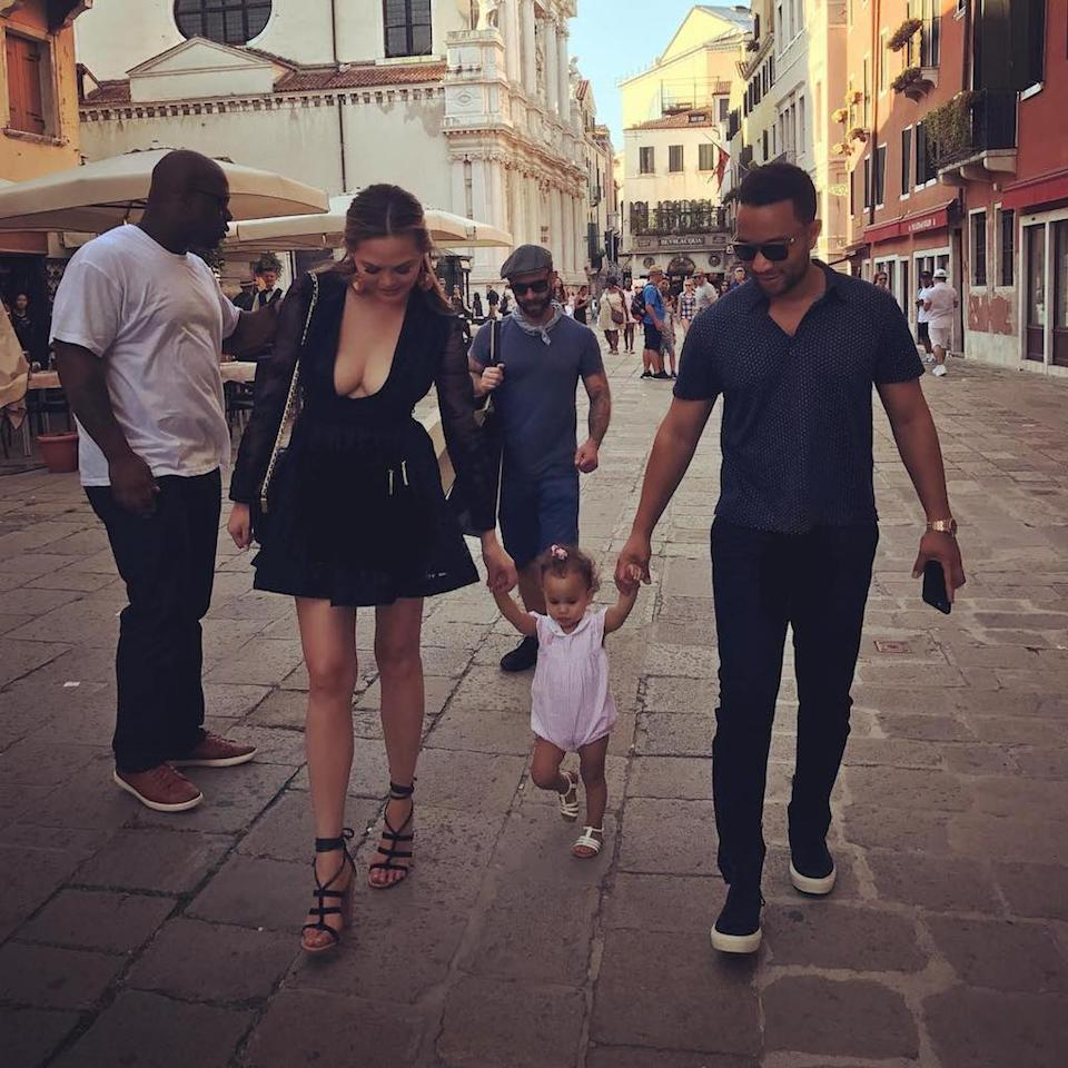 "<p>Now that's one good-looking family! Sandwiched between her parents, 16-month-old Luna enjoyed a walk down the cobblestone streets during her first Italian vacation. (Photo: <a rel=""nofollow"" href=""https://www.instagram.com/p/BXievsClsRu/?taken-by=chrissyteigen"">Chrissy Teigen via Instagram</a>)<br /><br /></p>"