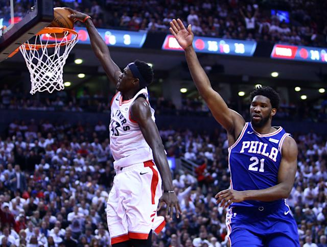 "The Raptors' <a class=""link rapid-noclick-resp"" href=""/nba/players/5658/"" data-ylk=""slk:Pascal Siakam"">Pascal Siakam</a> dunks as Joel Embiid is kind of just around on Tuesday night in Game 5. (Getty Images)"