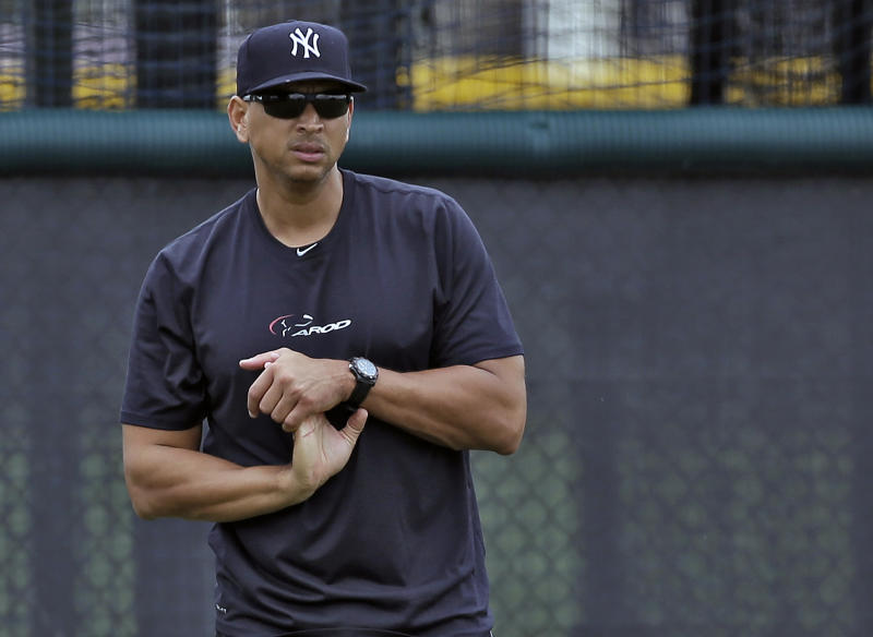 New York Yankees third baseman Alex Rodriguez stretches his wrist during a workout Wednesday, June 5, 2013, at the Yankees' minor league complex in Tampa, Fla. Major League Baseball has begun interviewing players linked to a Miami anti-aging clinic that allegedly sold performance-enhancing drugs and  became the focus of the sport's investigation. Rodriguez is among more than a dozen players whose names have been tied to the now-closed clinic, Biogenesis of America.(AP Photo/Chris O'Meara)
