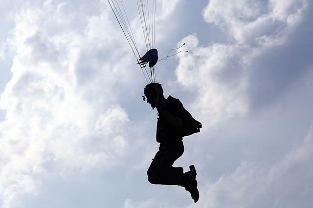 Man arrested as woman plummets 4,000ft in failed skydive