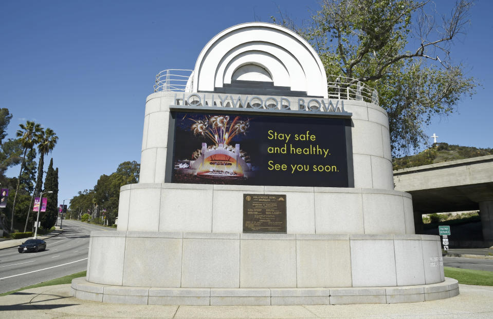FILE - This March 27, 2020, file photo shows a video monitor at the entrance to the Hollywood Bowl with a coronavirus-related message in Los Angeles. (AP Photo/Chris Pizzello, File)