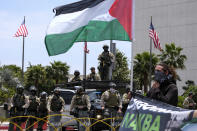 Police officers stand guard during in a protest outside the Federal Building against Israel and in support of Palestinians, Saturday, May 15, 2021 in the Westwood section of Los Angeles. (AP Photo/Ringo H.W. Chiu)