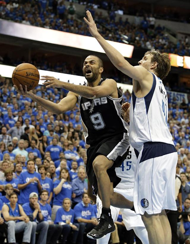 San Antonio Spurs' Tony Parker (9), of France, goes up for a score against Dallas Mavericks' Dirk Nowitzki, of Germany, late in the second half of Game 6 of an NBA basketball first-round playoff series on Friday, May 2, 2014, in Dallas. The Mavericks won 113-111. (AP Photo/Tony Gutierrez)