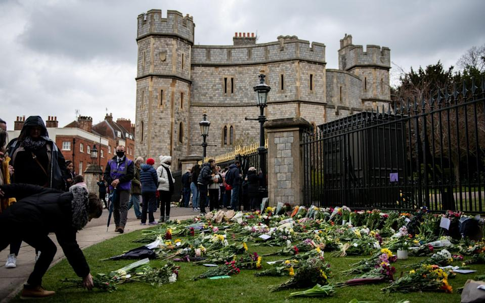 Crowds place floral tributes to the Duke at Windsor Castle