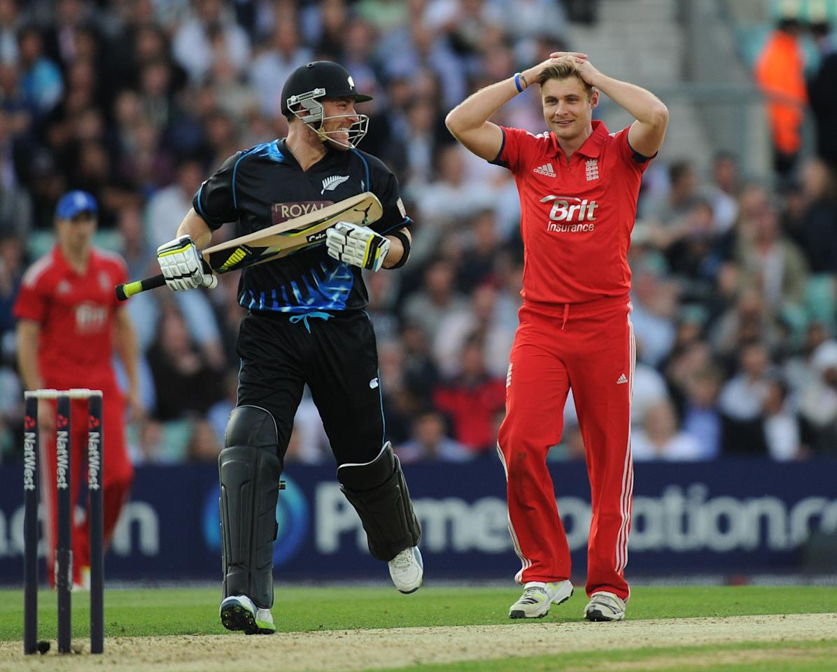 England's Luke Wright (centre) reacts after losing an appeal for the wicket of New Zealand's Brendon McCullum (left) during the Natwest International Twenty20 match at the Kia Oval, London.