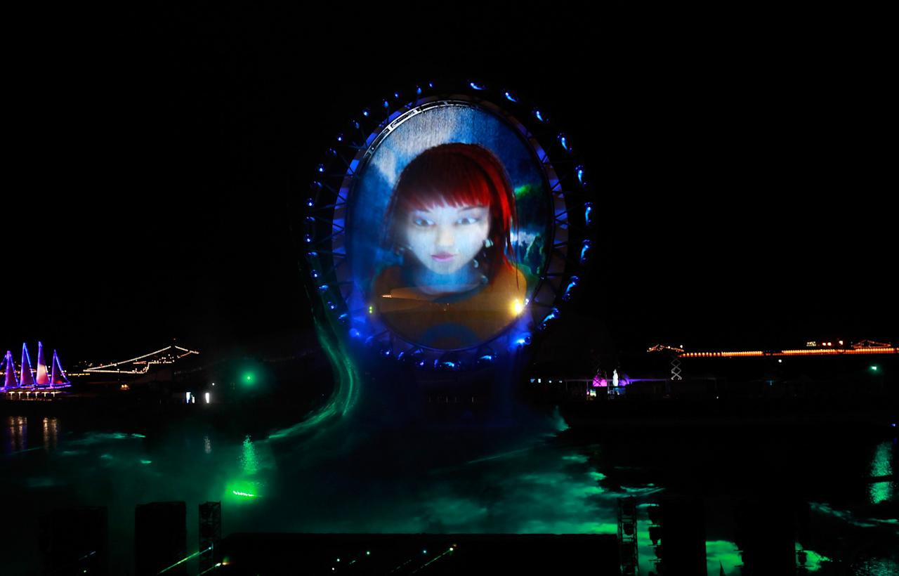 YEOSU, SOUTH KOREA - MAY 11:  The Big O - Marine Cultural Space, a giant circular strucure with lasers and a light show during the opening ceremony of the 2012 Yeosu Expo on May 11, 2012 in Yeosu, South Korea. More than 105 countries, 10 International Organizations and 10 million visitors are expected to participate in the expo that will open to the public on May 12 to August 12.  (Photo by Chung Sung-Jun/Getty Images)