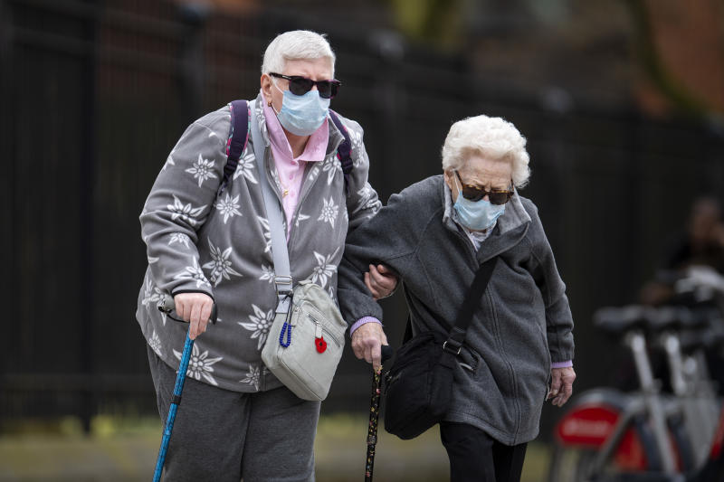 LONDON, UNITED KINGDOM - APRIL 01: Elderly members of the public wearing face masks walk down a street in Central London on April 01, 2020 in London, England. The Coronavirus (COVID-19) pandemic has spread to many countries across the world, claiming over 40,000 lives and infecting hundreds of thousands more. (Photo by Justin Setterfield/Getty Images)