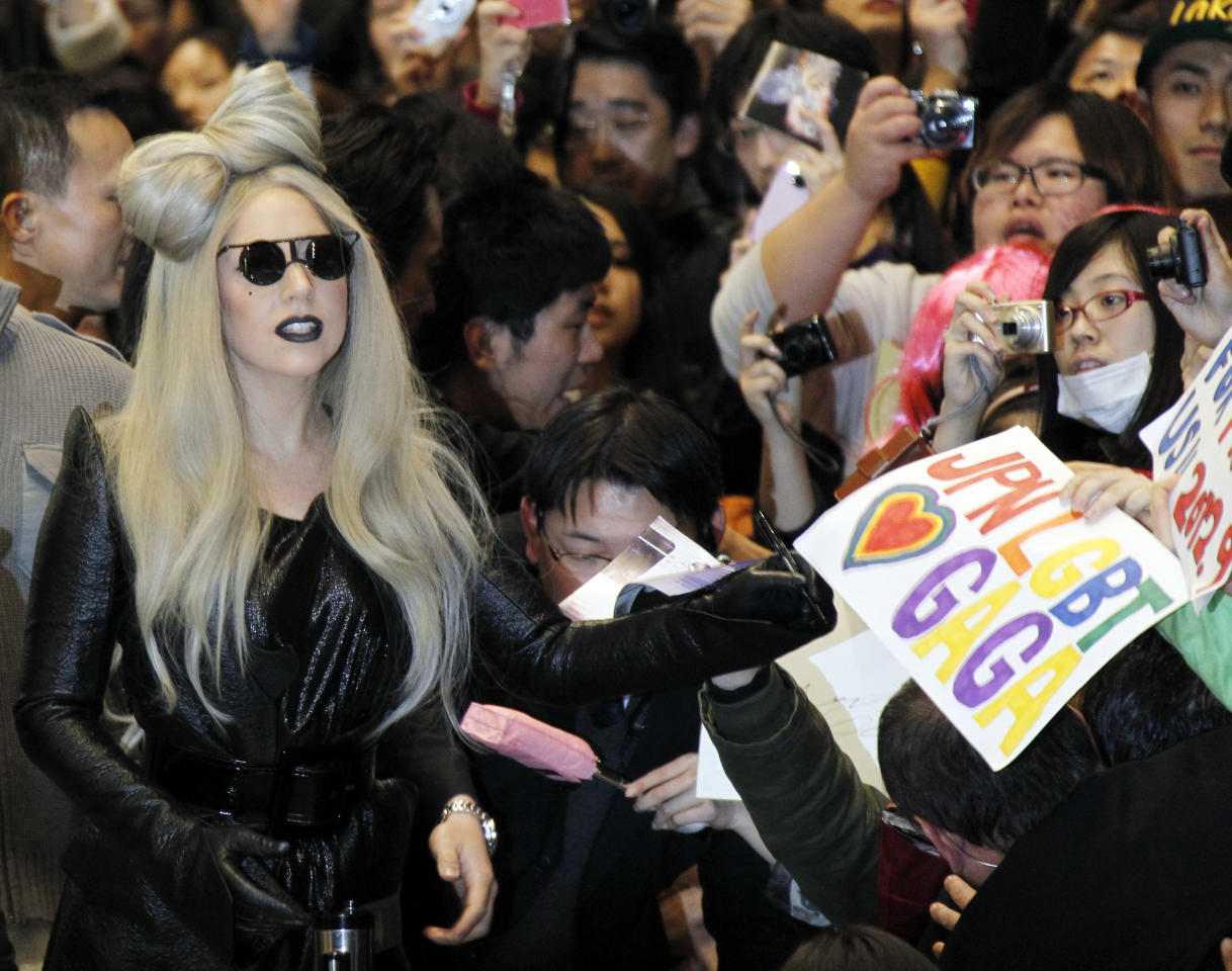 Singer Lady Gaga arrives at Narita international airport in Narita, east of Tokyo,Tuesday, Dec. 20, 2011. Lady Gaga is in Tokyo for a music event. (AP Photo/Koji Sasahara)