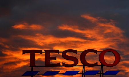 FILE PHOTO: A company logo is pictured outside a Tesco  supermarket in Altrincham northern England, April 16, 2016. REUTERS/Phil Noble