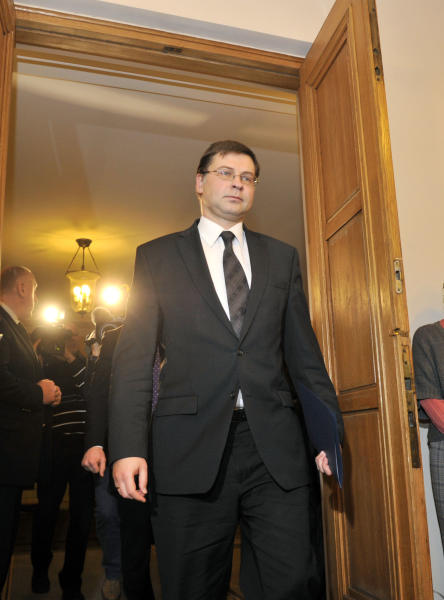 Latvia's Prime Minister Valdis Dombrovskis arrives for a press conference in Riga, Latvia, Wednesday, Nov. 27, 2013. Latvia's prime minister resigned Wednesday, after accepting political responsibility for the collapse of a supermarket roof in the capital that killed 54 people and wounded at least 40 others. (AP Photo/Roman Koksarov)