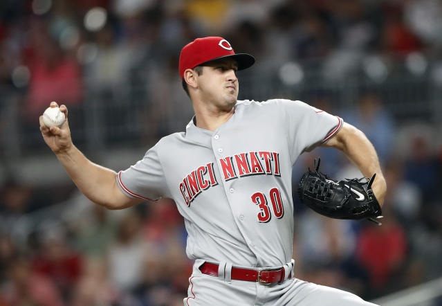 Cincinnati Reds starting pitcher Tyler Mahle (30) works in the first inning of a baseball game against the Atlanta Braves Monday, June 25, 2018, in Atlanta. (AP photo/John Bazemore)