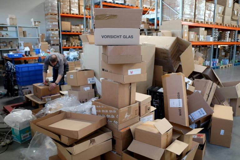 An employee sorts products at a warehouse of the non-profit Innatura cooperative, in Cologne, western Germany