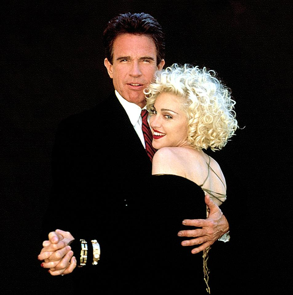 """<p>Beatty coupled up with Madonna while making 1990's <i>Dick Tracy</i>, and he appeared briefly in her <i>Truth or Dare</i> documentary. Years later, in a 2015 interview with Howard Stern, Madge revealed that even she was impressed by Beatty. """"Yes, he was [an incredible lover]. <a rel=""""nofollow"""" href=""""http://www.accesshollywood.com/articles/madonna-dated-tupac-shakur-5-other-surprises-from-the-singer-158528/"""">I'm not going to lie</a>,"""" she said. (Photo: Buena Vista Pictures/Courtesy Everett Collection) </p>"""