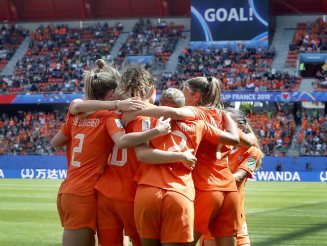Netherlands' players celebrate their side's 2nd goal scored by Dominique Bloodworth during the Women's World Cup Group E soccer match between the Netherlands and Cameroon at the Stade du Hainaut in Valenciennes, France, Saturday, June 15, 2019. (AP Photo/Michel Spingler)