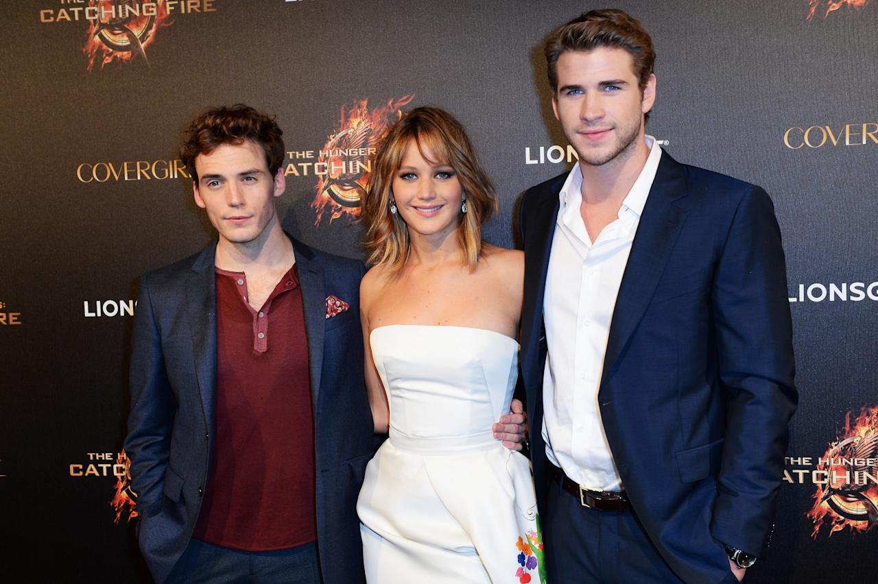 CANNES, FRANCE - MAY 18:  Sam Claflin, Jennifer Lawrence and Alan Ritchson attend 'The Hunger Games: Catching Fire' Party during The 66th Annual Cannes Film Festival at Baoli Beach on May 18, 2013 in Cannes, France.  (Photo by Samir Hussein/Getty Images)