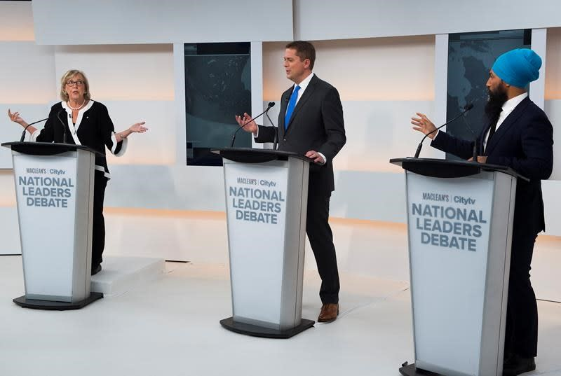 Despite agreements, Singh, May spar on stage during campaign's first debate