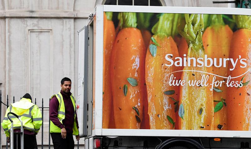 Workers unload a Sainsbury's home delivery van in central London