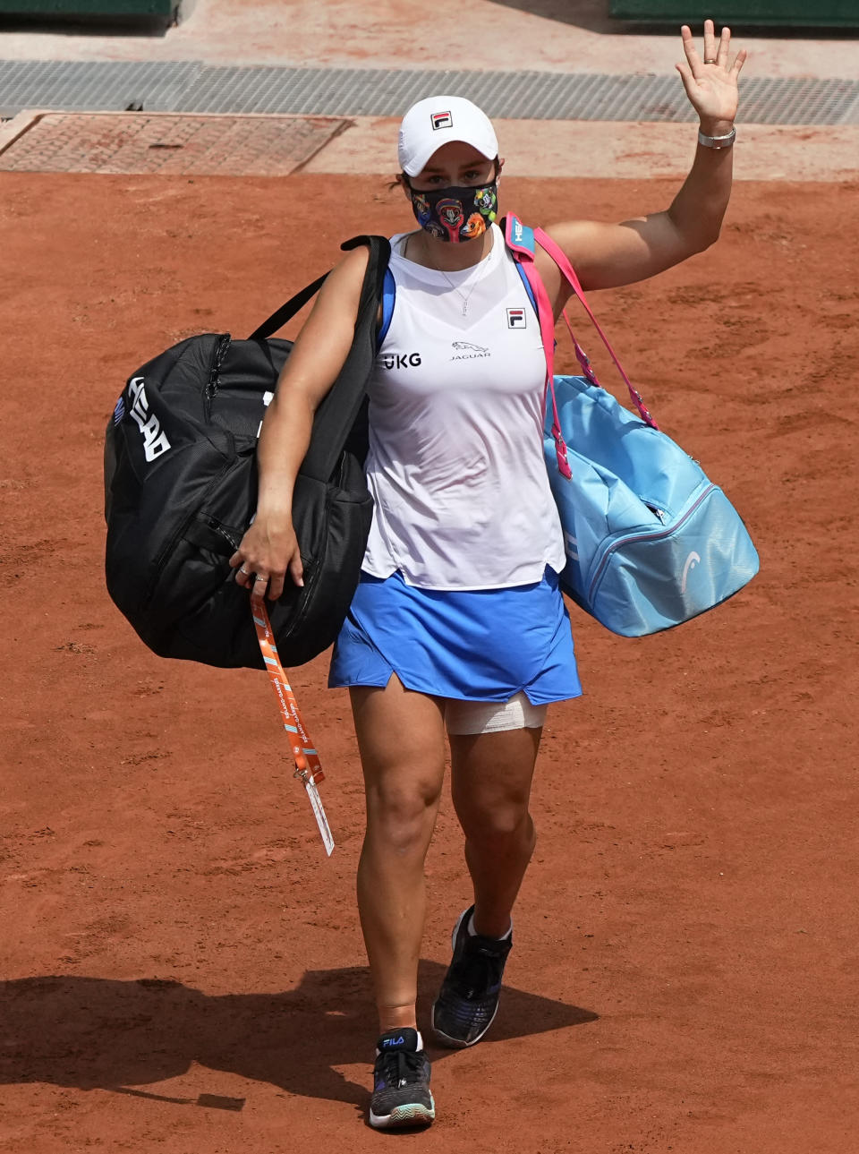 Australia's Ashleigh Barty waves goodbye as she retires with an injury as she was playing againstPoland's Magda Linette during their second round match on day 5, of the French Open tennis tournament at Roland Garros in Paris, France, Thursday, June 3, 2021. (AP Photo/Michel Euler)