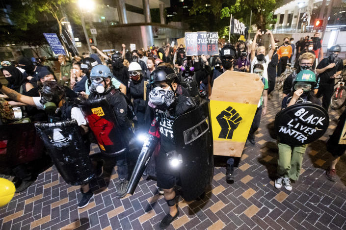 Black Lives Matter protesters march through Portland, Ore. after rallying at the Mark O. Hatfield United States Courthouse on Sunday, Aug. 2, 2020. Following an agreement between Democratic Gov. Kate Brown and the Trump administration to reduce federal officers in the city, nightly protests remained largely peaceful without major confrontations between demonstrators and officers. (AP Photo/Noah Berger)