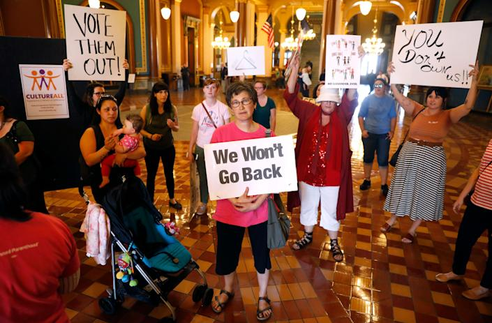 Protesters rally outside Iowa Gov. Kim Reynolds's formal office, Friday, May 4, 2018, at the statehouse in Des Moines, Iowa. (Photo: Charlie Neibergall/AP)