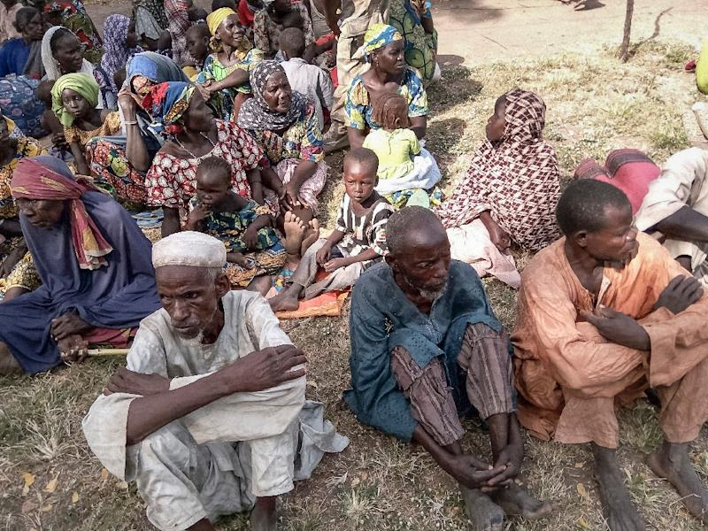 A handout picture provided by the Nigerian army on October 28, 2015 shows some of the 338 people held by Boko Horom after they were rescued during an army operation and evacuated to Mubi (AFP Photo/-)
