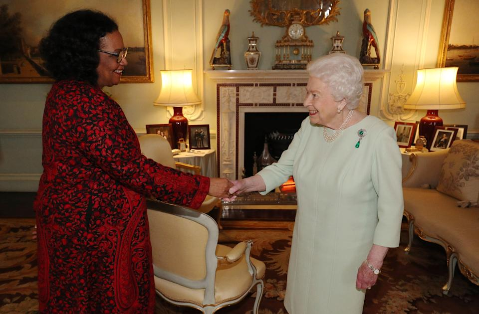 Britain's Queen Elizabeth II (R) presents Jamaican poet Lorna Goodison with the Queen's Gold Medal for Poetry during an audience at Buckingham Palace in central London on March 5, 2020. (Photo by Jonathan Brady / POOL / AFP) (Photo by JONATHAN BRADY/POOL/AFP via Getty Images)