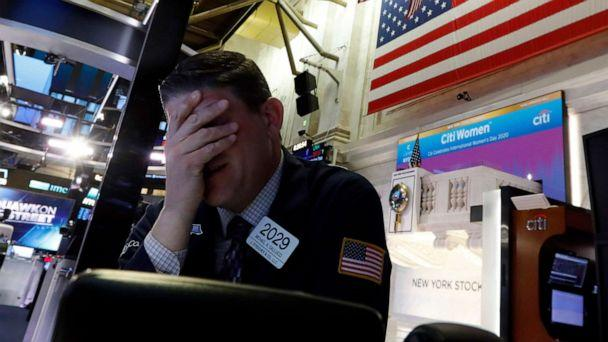 PHOTO: Trader Michael Gallucci prepares for the day's activity on the floor of the New York Stock Exchange, March 9, 2020. (Richard Drew/AP)
