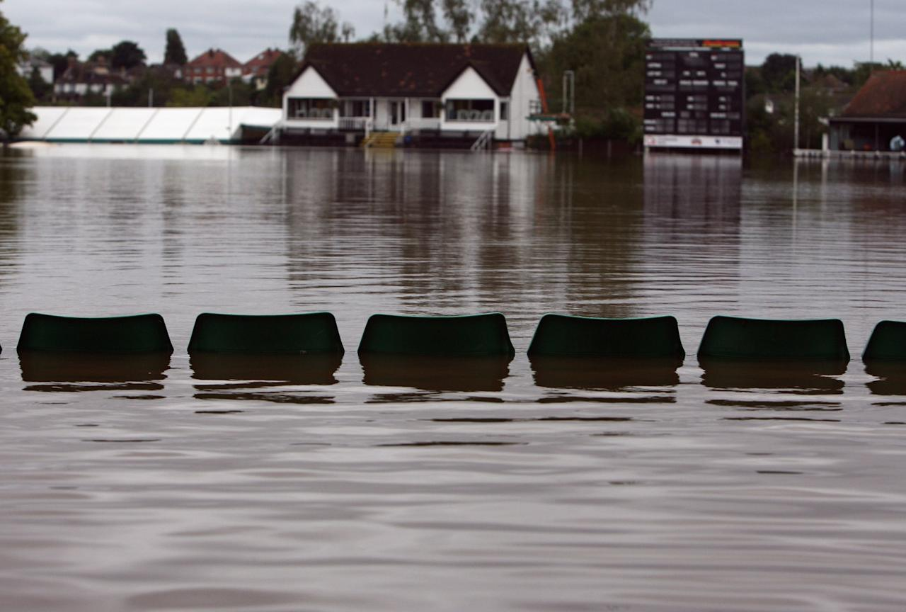 WORCESTER, UNITED KINGDOM - SEPTEMBER 07:   Spectators seats are nearly covered by rising flood waters on the Worcestershire County Cricket Club ground on September 7, 2008 in Worcester, England. Heavy rain, as much as one months rainfall in 24 hours, has caused flash floods and flooding, leading to widespread disruption to many parts of the UK.  (Photo by Matt Cardy/Getty Images)