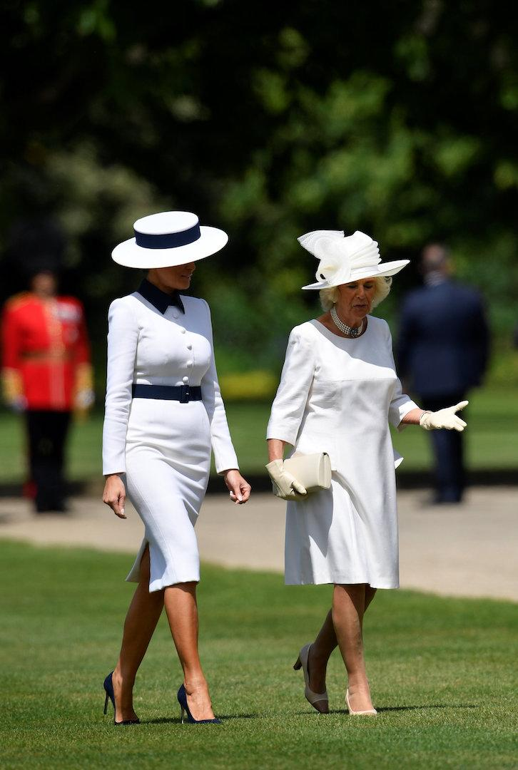 Melania Trump and the Duchess of Cornwall shared a surprise matchy-matchy moment for afternoon tea at Buckingham Palace. The First Lady chose a chic cream and navy long-sleeve dress by Dolce and Gabbana finished with a regal bespoke hat by Hervé Pierre. [Photo: Getty]