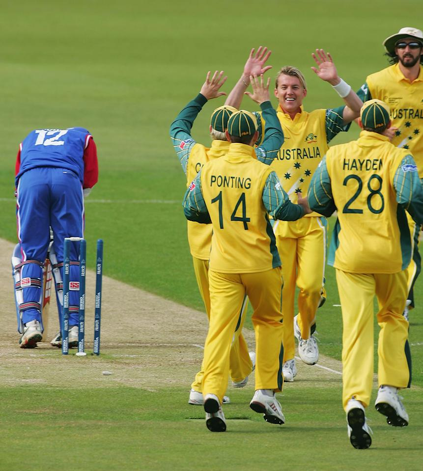 SOUTHAMPTON, ENGLAND - SEPTEMBER 13:  Brett Lee of Australia is congratulated by team-mates having bowled Mark Johnson of USA second ball during the ICC Champions Trophy match between Australia and USA on September 13, 2004 at the Rosebowl in Southampton, England. (Photo by Mike Hewitt/Getty Images)