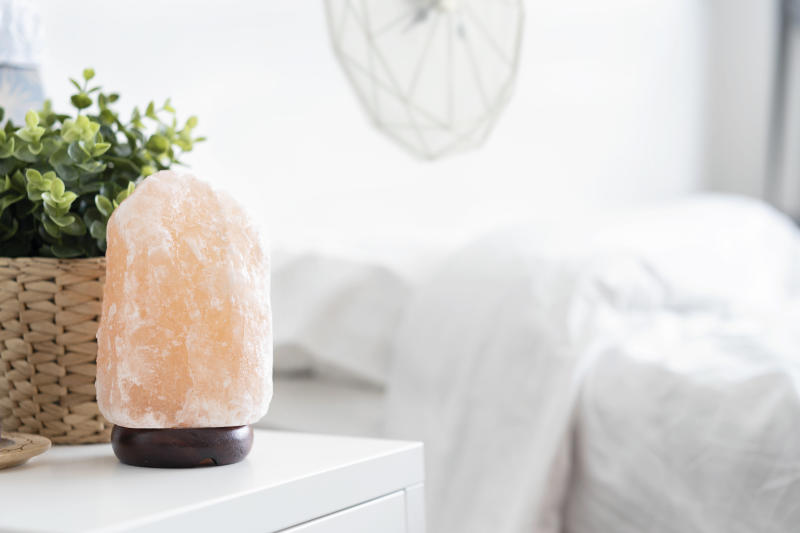 "Himalayan salt lamps are said to ""cleanse the air"" with their gentle glow. [Photo: Getty]"