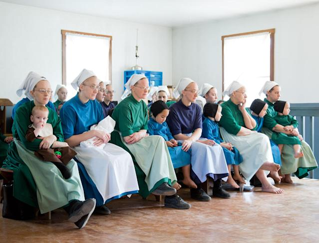 Amish women fill-up the school house to listen to their children sing during the final day of class on Tuesday, April 9, 2013 in Bergholz, Ohio. (AP Photo/Scott R. Galvin)