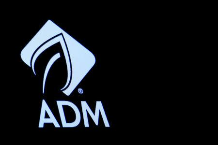 The Archer Daniels Midland Co. (ADM) logo is displayed on a screen on the floor of the NYSE in New York