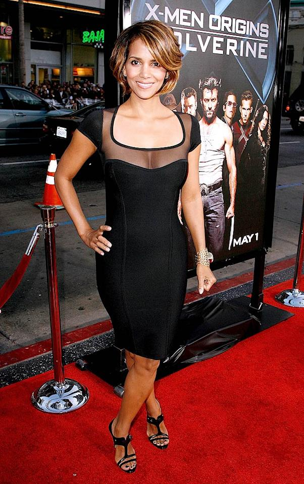 "Halle Berry wowed the crowd at the LA premiere of ""Wolverine"" in a fabulous form-fitting Herve L. Leroux dress, gold cuff, and $450 Camilla Skovgaard Barbero strappy heels. Jeff Vespa/<a href=""http://www.wireimage.com"" target=""new"">WireImage.com</a> - April 28, 2009"