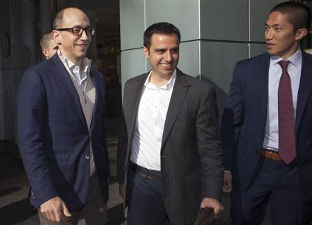 Dick Costolo (L), chief executive of Twitter, departs Morgan Stanley in advance of the firm's IPO in New York, October 25, 2013. REUTERS/Carlo Allegri